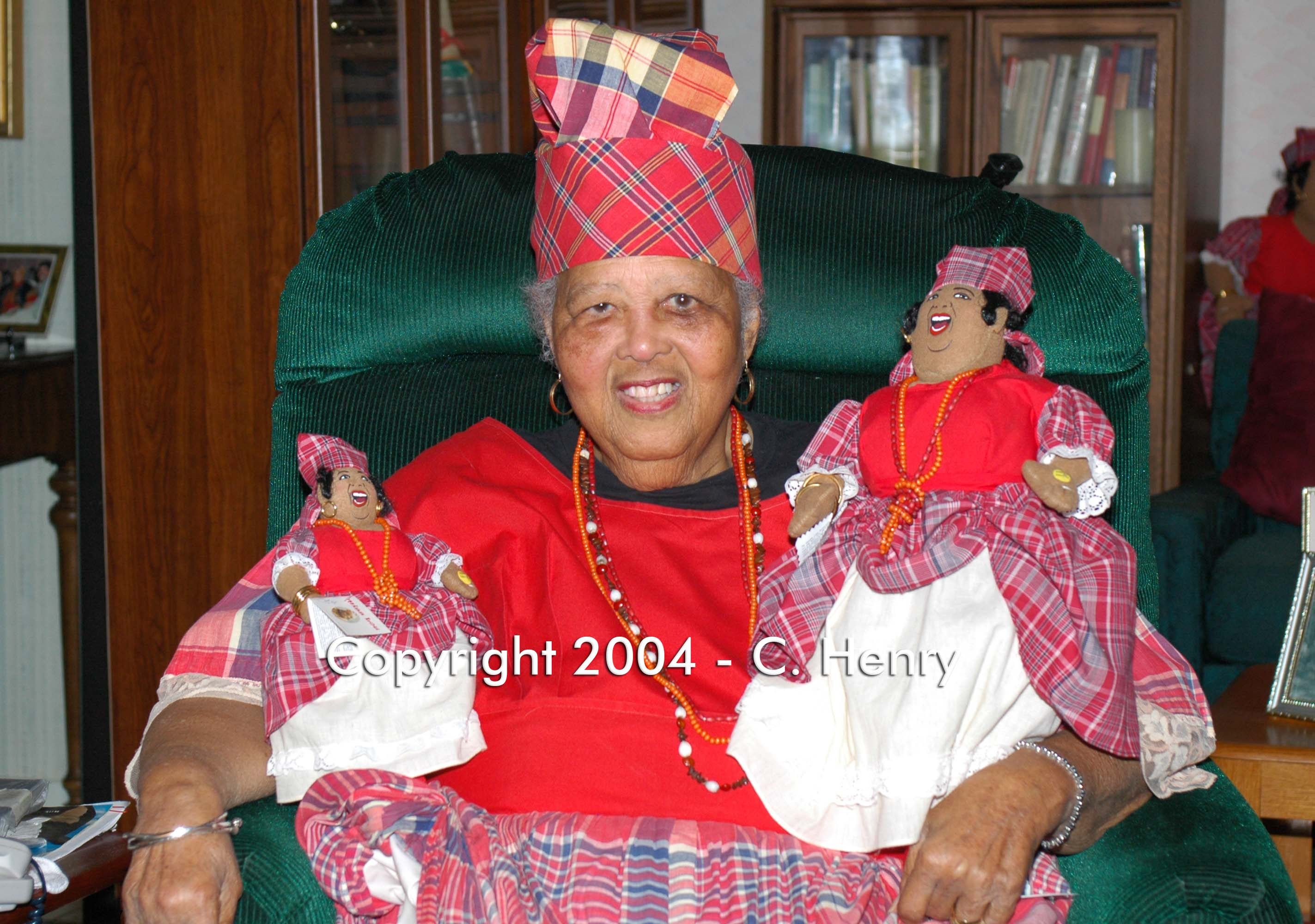 Miss Lou with dolls in bandanna outfits